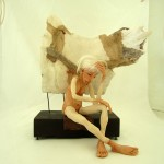 "SOLD : questioning : mixed media : polymer clay, bone, feathers  9""w 8d 10h"